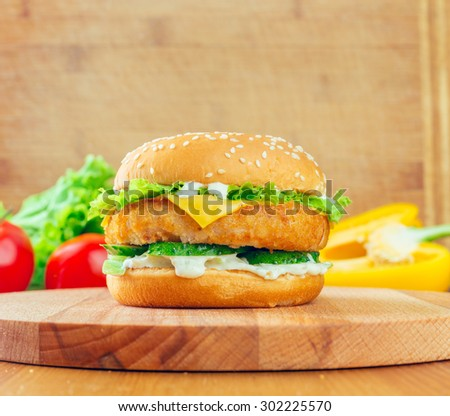 Fresh tasty chicken burger - stock photo