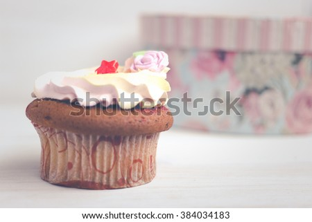 Fresh tasty cupcake on white wooden table. Food background. Beautiful eating. Sweet home concept.