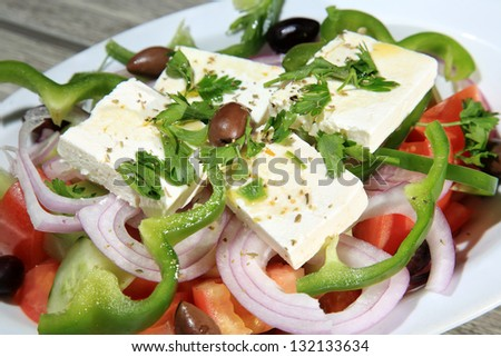 fresh tasty greek salad served on a plate - stock photo