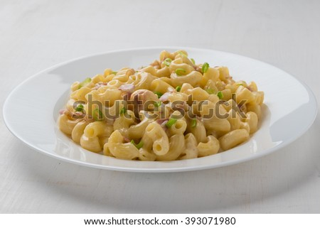 fresh tasty macaroni and cheese on white plate - stock photo