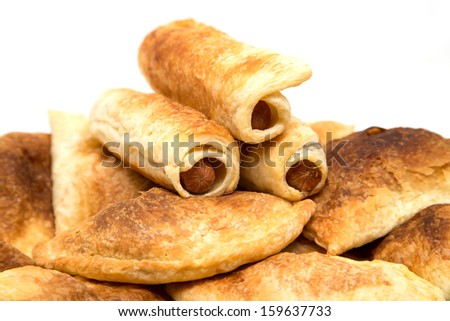 fresh tasty meat pies on a white background