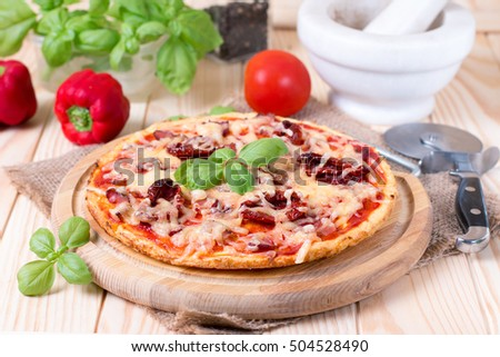 Fresh tasty pizza on wooden background