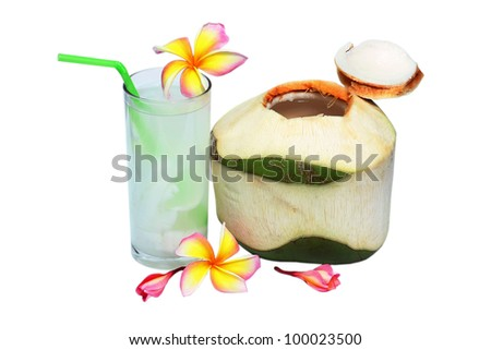 fresh tender green coconut drink on tropical beach