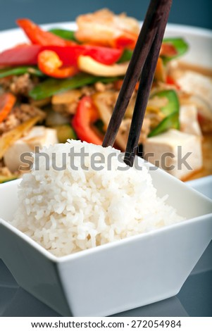 Fresh Thai food stir fry with tofu and white jasmine rice.  - stock photo