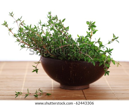 Fresh thyme in a wooden bowl