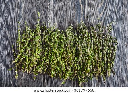 Fresh thyme on wood backround  - stock photo