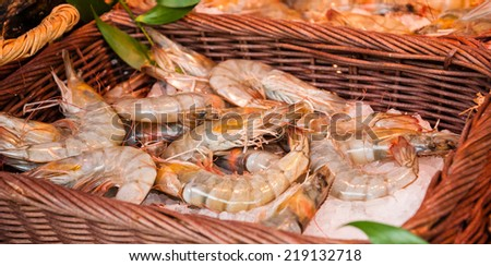 Fresh Tiger shrimps on the stall outside fish store in Paris (France). - stock photo