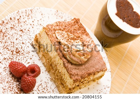 Fresh tiramisu with raspberries and cappuccino - stock photo