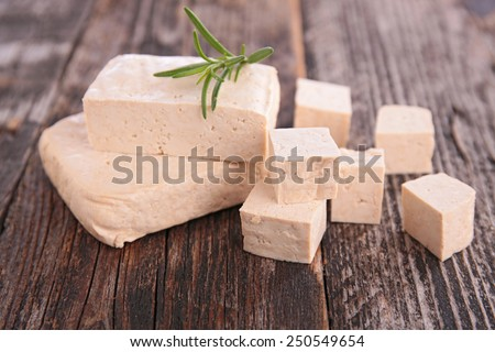fresh tofu on table - stock photo