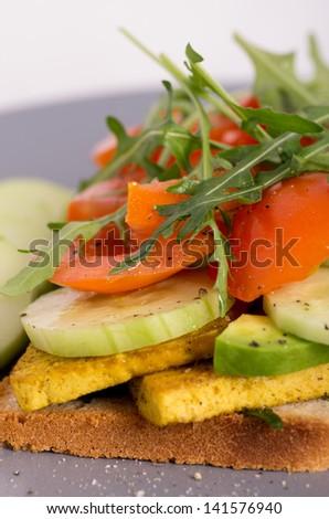 Fresh Tofu Veggie Sandwich. Vegan Burger with tofu and tomatoes - stock photo