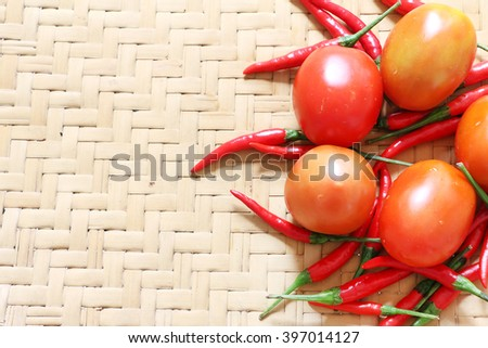Fresh tomato and chili on bamboo mat