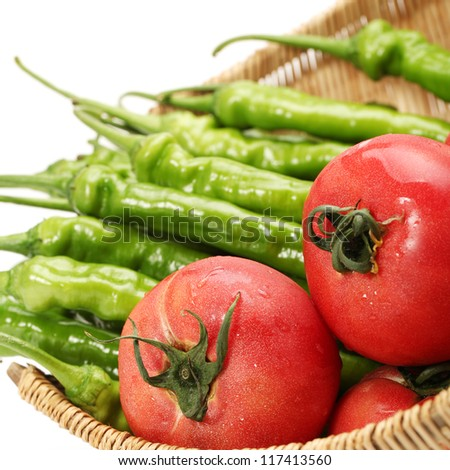 fresh tomato and green peppers isolated on white background
