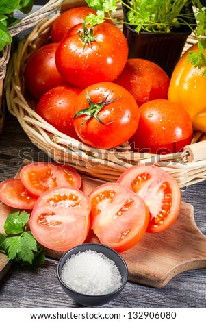 Fresh tomato and herbs in a basket