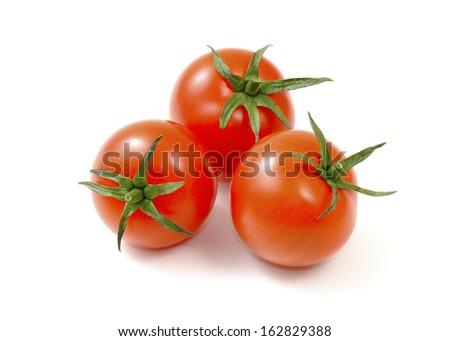 Fresh tomato isolated on white background. - stock photo