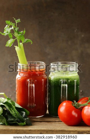 Fresh tomato juice and juice of spinach, celery (smoothies), detox and healthy food  - stock photo