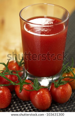 Fresh tomato juice garnished with fresh cherry tomatoes - stock photo