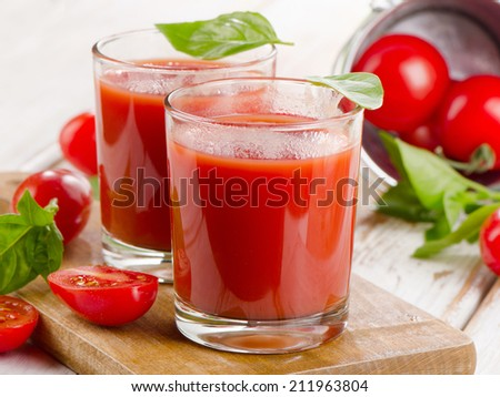 Fresh tomato juice with ripe tomatoes and herbs . Selective focus
