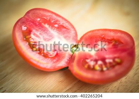 Fresh tomato on wood background - stock photo