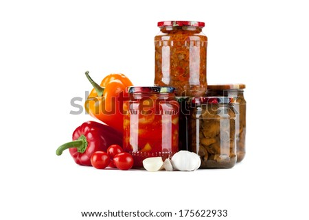 Fresh tomato sauce homemade and canned mushrooms with peppers and tomatoes in the glass jar.