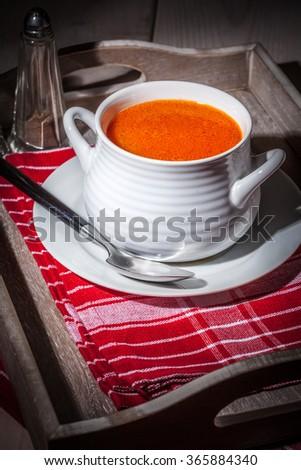 Fresh tomato soup in a white bowl. Selective focus. - stock photo