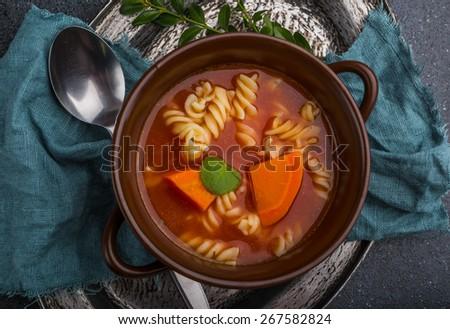 Fresh tomato soup in stoneware bowl - stock photo