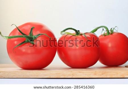 fresh tomato wooden plank kitchen  - stock photo