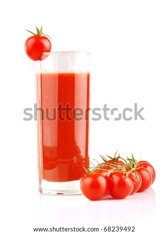 Fresh tomatoes and a glass full of tomato juice