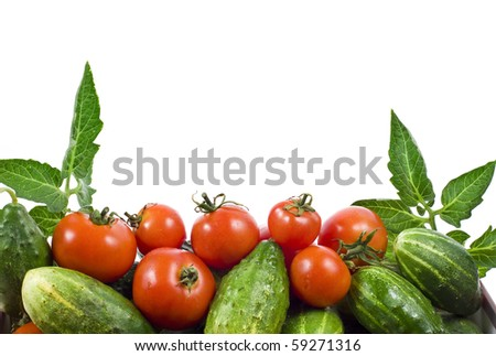 fresh tomatoes and cucumbers isolated on white - stock photo