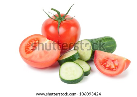 Fresh tomatoes and cucumbers, isolated over white