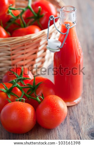 Fresh tomatoes and juice in bottle, selective focus - stock photo