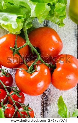 Fresh tomatoes and other ingredients for the salad - stock photo
