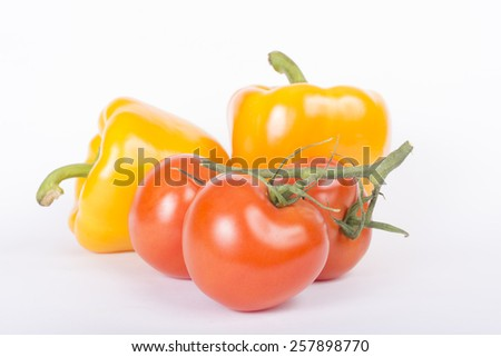Fresh tomatoes and sweet peppers isolated on white background - stock photo