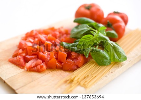 Fresh tomatoes basil and pasta ready to cook