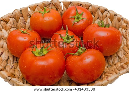 fresh tomatoes in a basket on a white background,tomatoes in the basket - stock photo