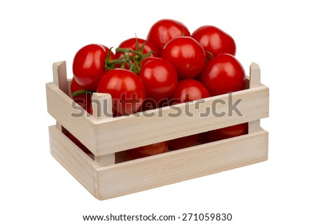Fresh tomatoes in the wooden box isolated. - stock photo