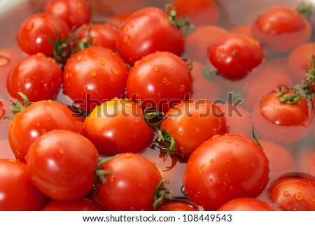 Fresh tomatoes in water