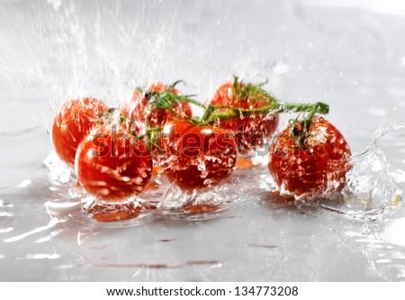 fresh tomatoes in water splash - stock photo