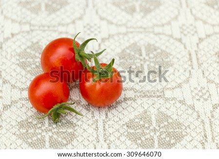 Fresh tomatoes on a linen background