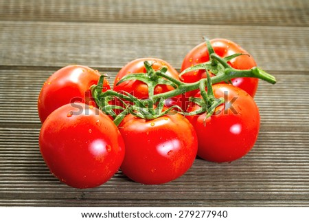 Fresh tomatoes on a wooden table - stock photo