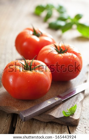 fresh tomatoes on cutting board