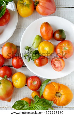 fresh tomatoes on plate, food above - stock photo