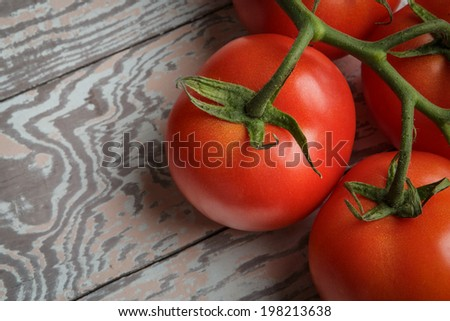 Fresh Tomatoes on Rustic Wooden Table