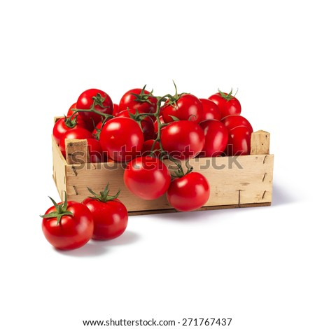 Fresh tomatoes on wooden box