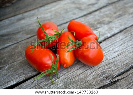 fresh tomatoes over wood - stock photo