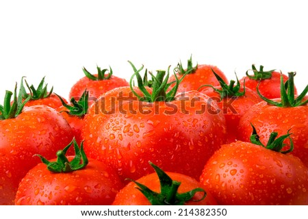 Fresh tomatoes with drops of water isolated on white background - stock photo