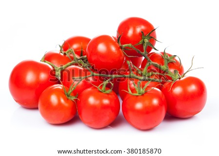 fresh tomatoes with green leaves isolated on white background - stock photo