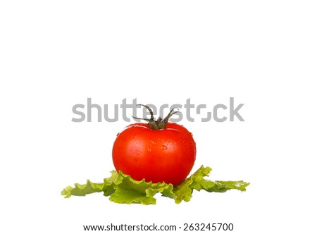 Fresh tomatoes with lettuce leaf isolated on white - stock photo