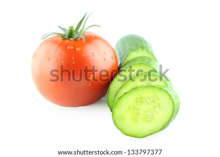 fresh tomatoes with Slices of cucumber on white background.  with a clipping path