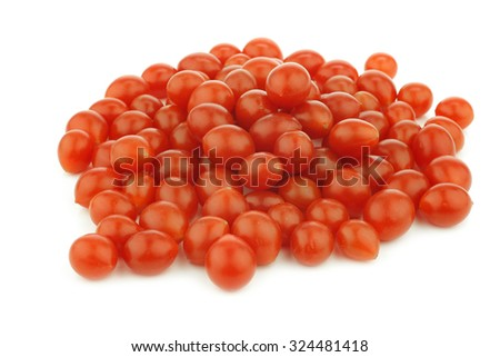 fresh tomberry tomatoes (very small) on a white background - stock photo