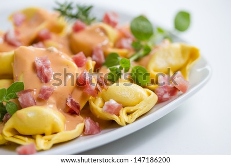 fresh tortellini in light sauce with ham